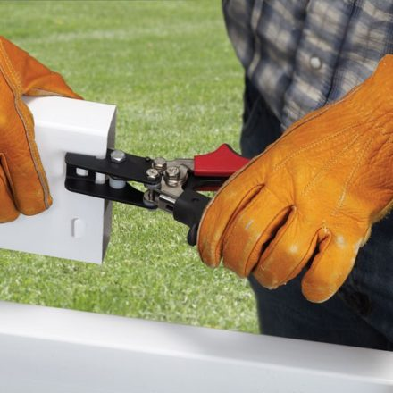 Man notching Vinyl Fence with Malco VFN2 Tool